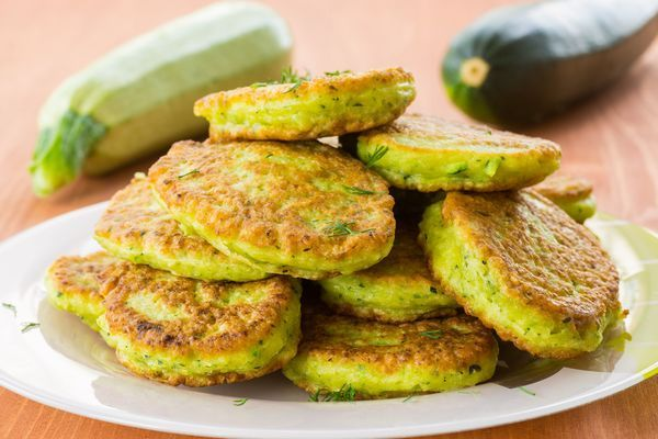Vegetarian Recipe: Zucchini Fritters (gonna sub flour for a gluten free flour...maybe quinoa... and instead use 1tblsp coconut oil and 1 tblsp grassfed butter for the olive oil, as it is only good for you if it is uncooked.)