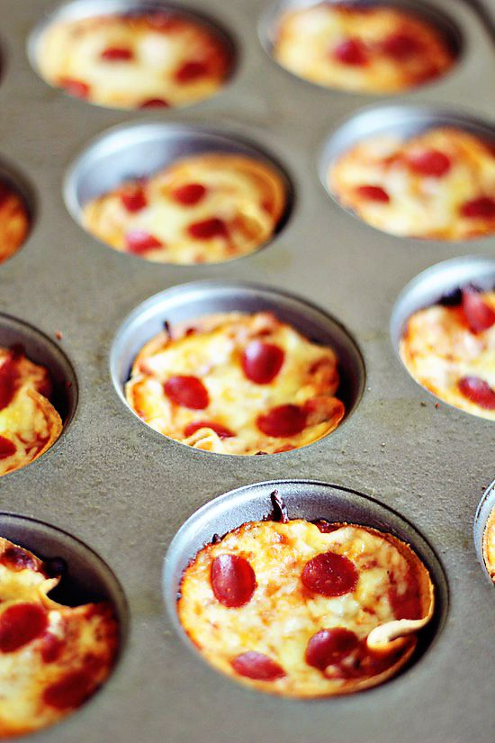 Mini Pizzas by Katie Farrell: Cut rounds from whole wheat tortillas with an empty can, cup or cookie cutter, tuck into muffin pans and pack in your favorite ingredients. #Mini_Pizzas #Pizza #Katie_Farrell