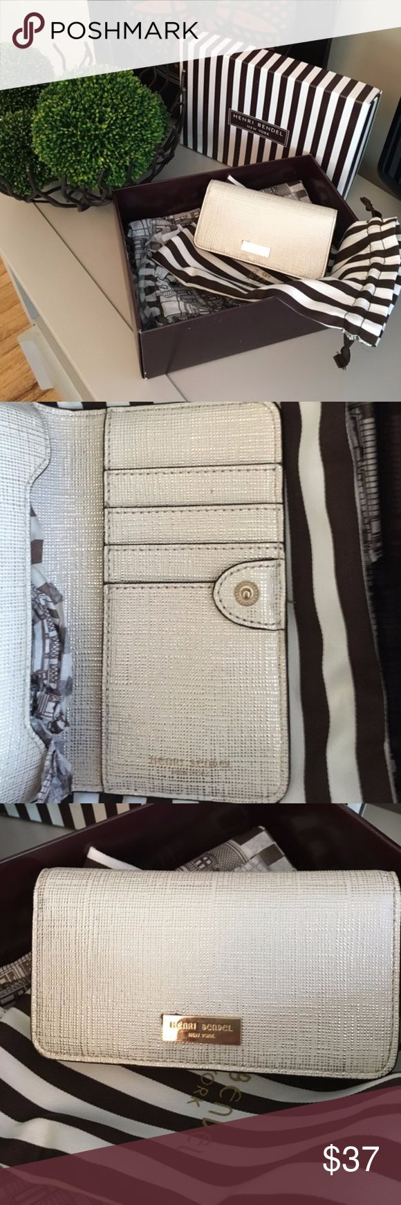 "Henri Bendel phone wallet/clutch This is a brand new Henri Bendel phone wallet that fits iPhone 6/6s. Glamorous metallic gold color with gold emblem on the front. Classic wallet that goes with any bag in mint condition! This is not available in stores or online! Wallet measures 6""x3.5"". Comes with tag, box and dust bag.  This is a re-posh because sadly my phone doesn't fit in the wallet with my case on... and I have a 3 year old so going without a case is not an option! henri bendel Bags…"