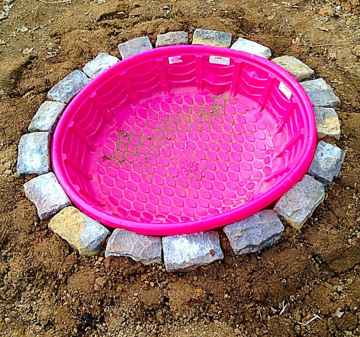 In-ground kiddie pool, for dogs or pigs :D