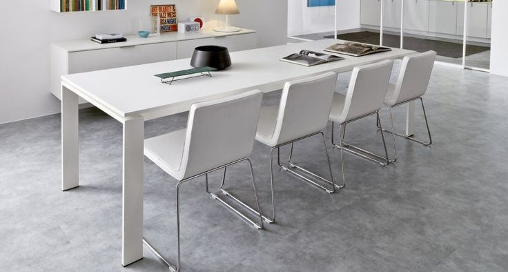 """Angolo All Table   Extendible table with painted metal top in melamine and melamine thermo-structured oak white 18 mm thick. Leather chair model """"Elle""""."""
