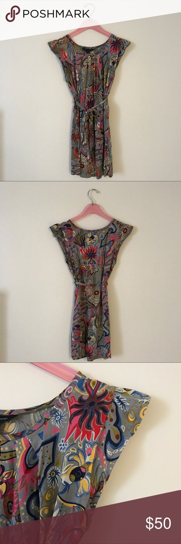 """* French Connection * Super cute sleeveless, cotton dress/tunic. Multi-colored and multi-pattern. Removable belt/tie. Pleated at neckline, nice detail. Size 4. I wore this as a dress and I'm 5'-5"""". Can be worn with leggings. Been worn a bunch of times but no signs of wear or tear. In very good condition. No odors. Non smoker. No trades please. Thank you. Happy shopping! French Connection Dresses"""