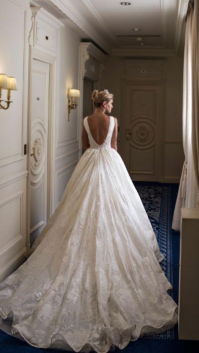 Elegant white ballgown wedding dress with v-shaped open back design; Featured Dress: Alessandra Rinaudo