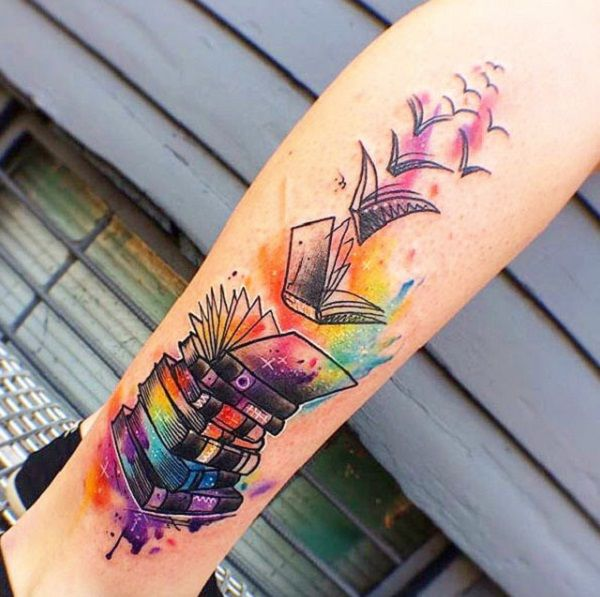 Books becoming Birds. The colorful tattoo of stack of books, that are gradually becoming birds is another inspiration for all the people who want to fly in heights while reading the books.