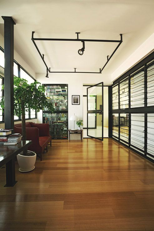 The evocative mix of materials include heavy black power-coated metal, glass, galvanised steel and warm wood. With a glass door and louvred window panes running across the walls, the study room enjoys plenty of natural light and wind.