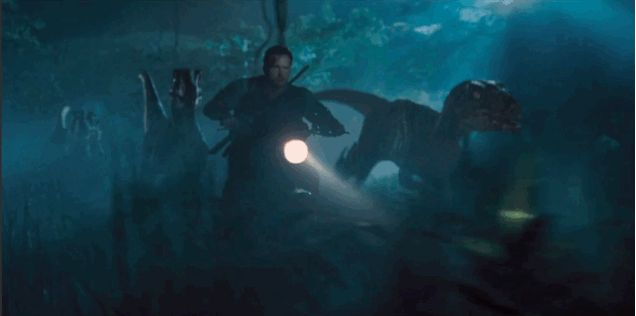 """But I can't argue with reading a script that says """"Owen revs up his bike and takes off in the woods, his loyal raptor pack screams and runs at his side.""""   io9: All the clues and WTF moments in the new Jurassic World trailer."""