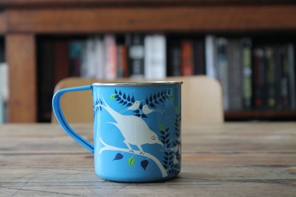 Hand-Painted Bird Mug This stunning enamelware mug is the perfect home accessory and gift. Each piece is beautifully hand painted by artisans in Kashmir. Whether for indoor or outdoor use it will keep your drink piping hot. Size: 9 x 8cm (dia) £7.95