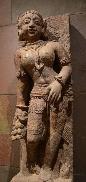 This 13th C. fertility goddess is holding a bunch of mangoes, which represent abundance and auspiciousness. The mango is a native Indian fruit.