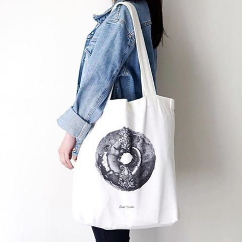 """""""Baked these lovely bags out for @dear.camille ! How adorable is that hand drawn doughnut! Not to mention it looks so yummy!  Get yours today! Check then out on her Instagram!  Photo cred: @dear.camille  #silkscreen #screenprint #tote #doughnut #fashion #melbourne #foodsketch #illustration #drawing #toteprint #halftone"""""""