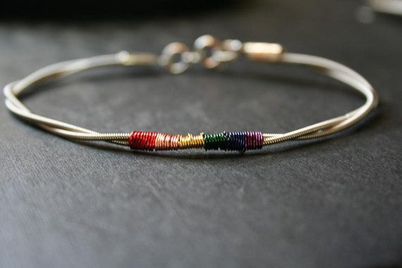 bass guitar string jewelry bracelet with rainbow pride colors accent jewelry bracelets. Black Bedroom Furniture Sets. Home Design Ideas