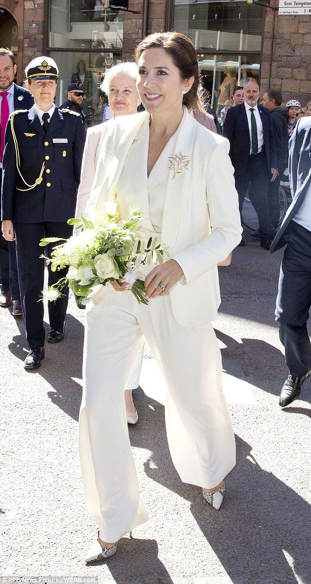 A vision in white: Princess Mary was her typical glamorous self in a cream trouser suit and snakeskin heels