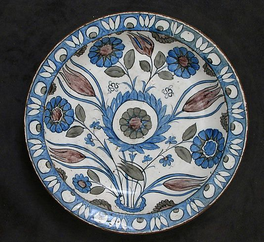 Dish with Floral Design Object Name: Dish Date: second half 16th century Geography: Turkey, Iznik Culture: Islamic Medium: Stonepaste; polychrome painted under transparent glaze Dimensions: H. 2 3/16 in. (5.6 cm) Diam. of rim: 12 1/8 in. (30.8 cm)