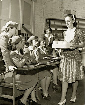 Flight Attendant School. Try this in heavy turbulence! Practice practice PRACTICE! With a smile .....