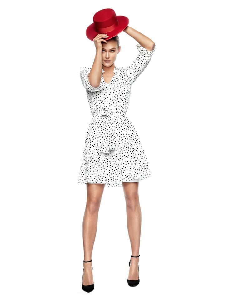 Rocking a hat, Bar Refaeli wears Pedro del Hierro dress with polka dots. Hat by Menkes and heels by Jimmy Choo.