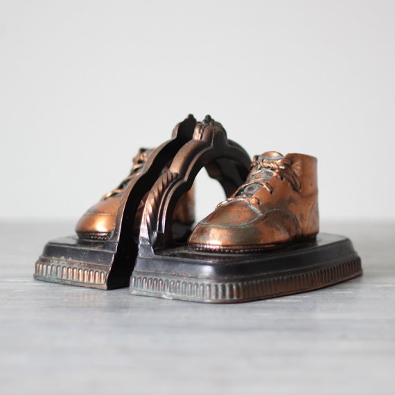 Bronzed baby shoes bookends. My Mom and Dad did this with my first baby shoes.
