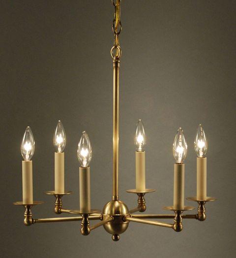 Chandelier 935 by northeast lantern shown in antique brass also available in raw brass dark antique brass dark brass and verdi gris
