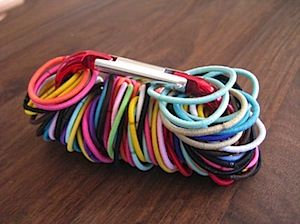 With long hair comes elastics.  Storing them on a carabiner has changed my life....super easy to access and simple to put away