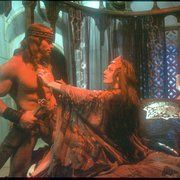 Arnold Schwarzenegger as Conan and Sarah Douglas as  Queen Taramis in Conan the Destroyer (1984)