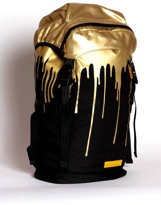 Great black and gold outfit for men, including as an item for accesorizing this cool back-pack.