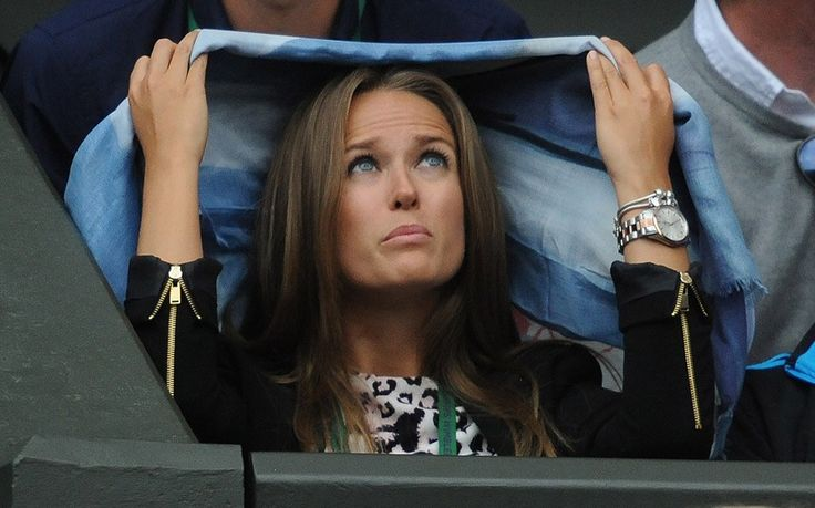 I can't stand the rain: Andy Murray's girlfriend Kim Sears protects her hair from rain while the roof is closed on Centre Court during his match at Wimbledon