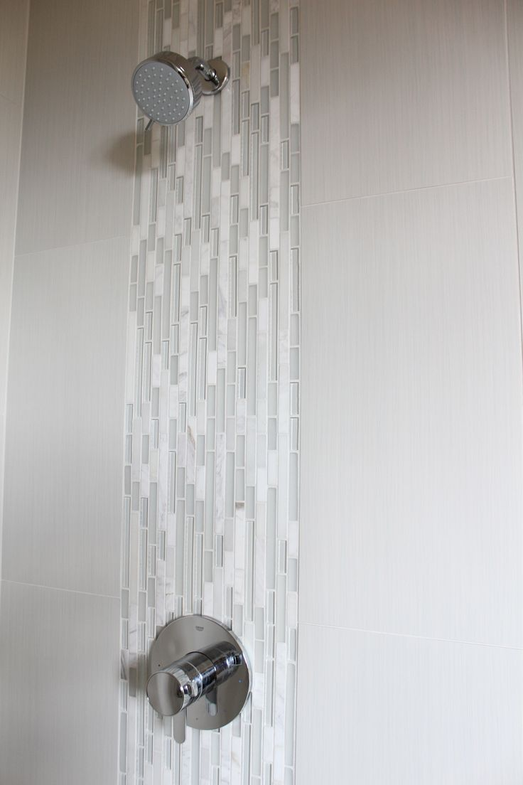 waterfall detail in master shower.  Emser tile, 12x24 strands in pearl vertically stacked with marble/glass detail running vertically behind shower hardware...creates a waterfall effect. Linen & Lilac linenandlilacdesign@gmail.com