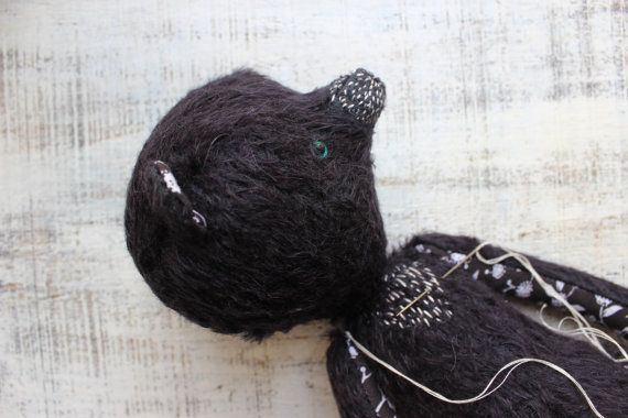 Large and one of a kind black teddy bear 100% handstitched of black mohair and vintage black and white cotton fabric. Random stitches were added to make him look like true himalayan bear. And he has got bright turquoise eyes! He is a very sweet and cuddly one made to be loved teddy bear of a boy or a girl of any age. One of a kind or not? Yes, its one of a kind. Materials Vintage cotton fabric, black mohair 100% wool, polyfill, glass beans, glass eyes. The bear is fully jointed with cotter…