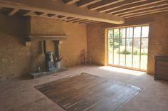 Aprés, réalisation d'une dalle béton de chaux, pose terre cuite sur dalle chaux, reconstruction cheminée, enduit pierre vue, taille et pose du solivage...