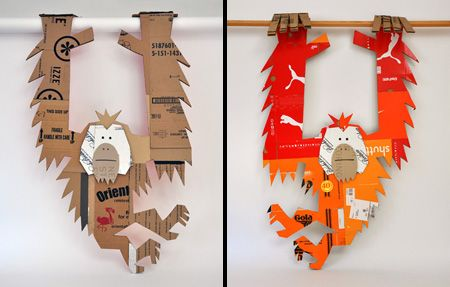 Hanging Orang from chip/cardboard.  http://bartalosillustration.com/2011/04/30/a-cardboard-menagerie-for-the-calacademy/