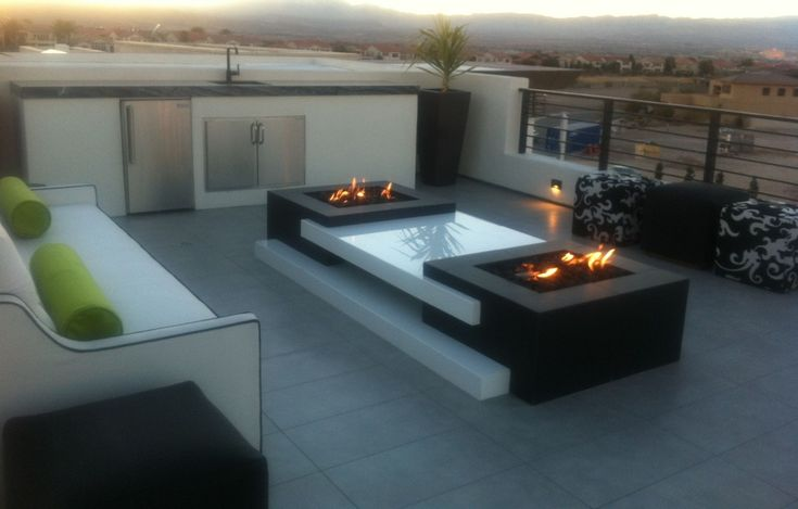 Modern Patio with Fire pit, exterior tile floors, exterior stone floors, Fence, Mezzo Square Propane Fire Table