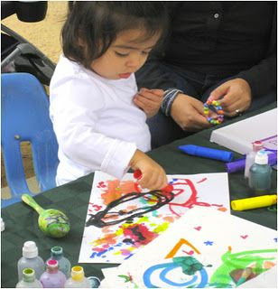 1.7  Let children paint whatever they want on the paper and they can stick things on it to make it different.