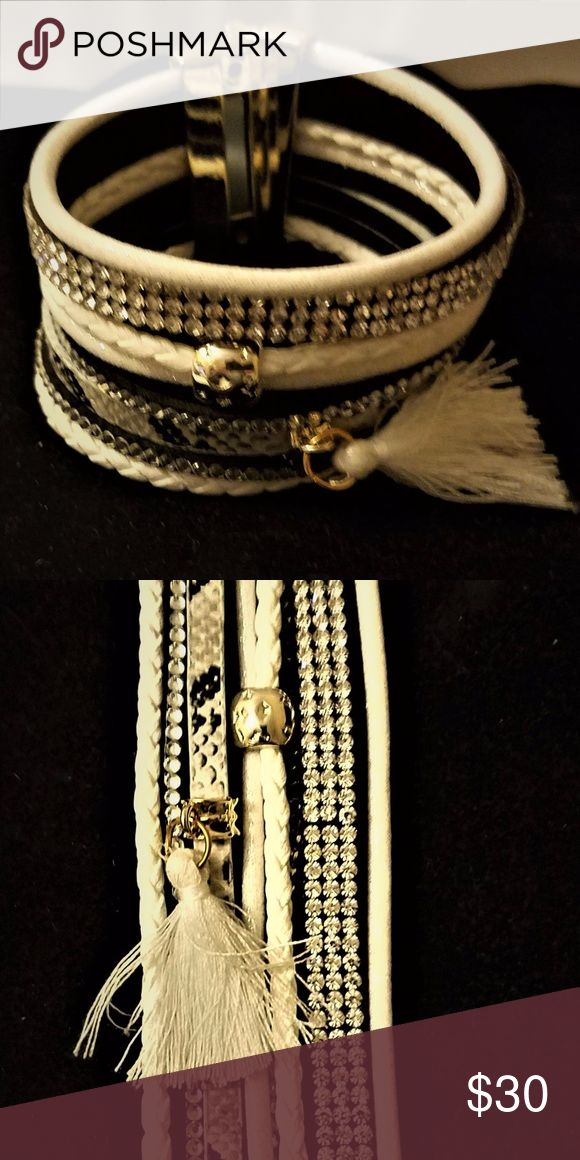 """JUST IN  6 Strand Wrap Tassel Bracelet One of a kind 6 Strand Wrap Bracelet   White, crystal and black strands with a metal clip   1 3/8"""" wide x 7 3/4"""" in length  A must have and will receive so many compliments.  Fashion bracelet that will look amazingly beautiful for any occasion ❤ Jewelry Bracelets"""