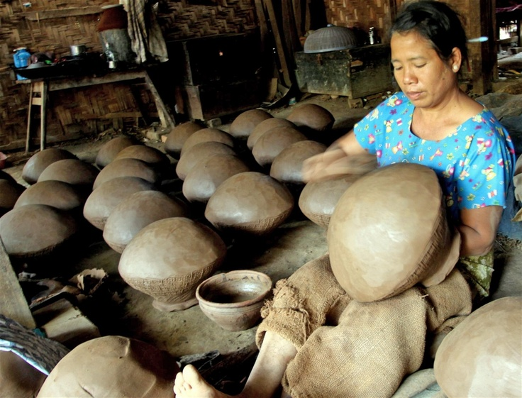 A woman makes pots at her home in Sagaing District, Myanmar