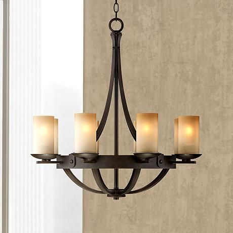 Rustic and chic, this bronze finish chandelier features gorgeous scavo glass and an elegant design.