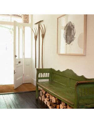 White and green entryway that has clean farmhouse decor