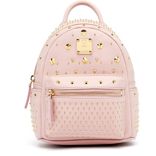 MCM Stark Special Backpack (52,020 PHP) ❤ liked on Polyvore featuring bags, backpacks, pink backpack, crossbody tote, leather studded backpack, leather backpacks and pink leather backpack