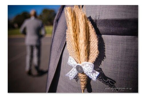 I made this wheat buttonhole for my husband, so it would match my wheat bouquet.