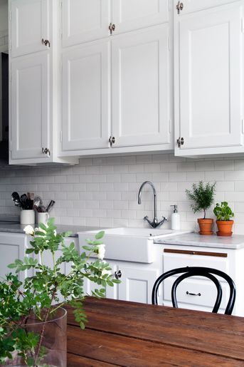 Simple white cabinetry, white subway tile, but I prefer a dark counter top... black, perhaps.  Clean, crisp.  Lovely.