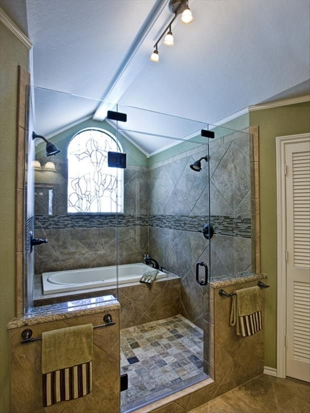 shower and tub in the same area.  never worry about a soaking wet bathroom floor after getting out of the tub