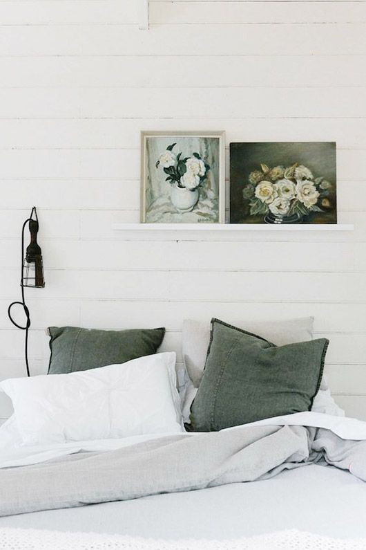 floral paintings on shiplap bedroom wall. / sfgirlbybay