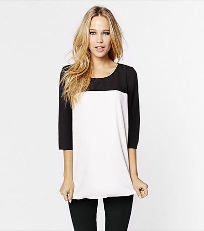 #DYNHOLIDAY Dress up your everyday look with this black & white colorblock tunic!