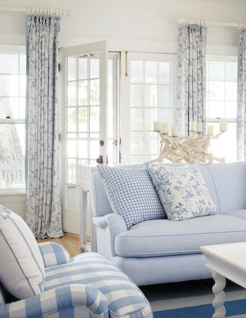 gingham sofa, floral curtains, striped rug and large check chair - same color ties the prints together without looking too busy or overwhelming.