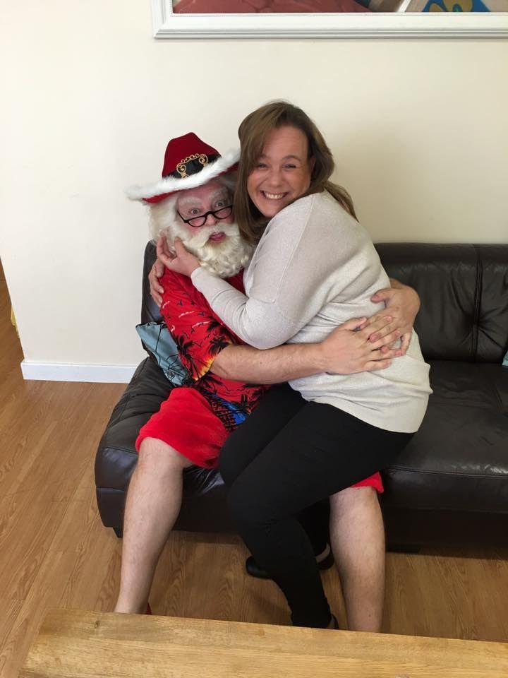 Jodie on Santa's knee at C & C