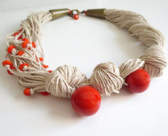 This necklace is made of light natural linen cord , 2 big tagua nut round orange beads , small tagua nut orange rondelle beads.