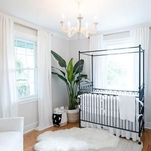 Black and white create such a sophisticated pallet for your baby's nursery.  Swooning over this simple canopy crib. #nursery #neutral