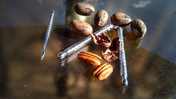 How to Crack Pecans - You boil them first. Never heard of this, may have to try sometime.