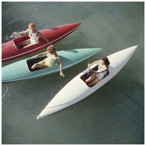 Young women canoeing on the Nevada side of Lake Tahoe, 1959 Slim Aarons