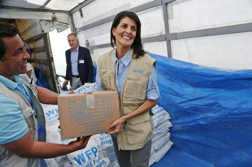 BAB AL-HAWA, Turkey-Syria Border/May 30, 2017 (AP)(STL.News) — Nikki Haley crouched low in the trailer of an 18-wheeler taping up a box of lentils and wheat for besieged Syrians, her hands-on diplomacy a world apart from the gleaming new NATO headq...