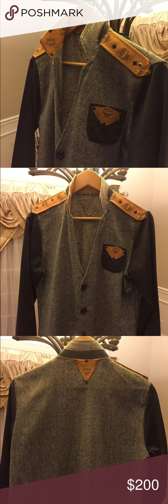 MCM This stunning tweed Jacket was customized by my tailor with MCM coated material.  As seen in pictures the collar is reversible so it can be worn up or down.  The size is equivalent to a US large. MCM Jackets & Coats Pea Coats