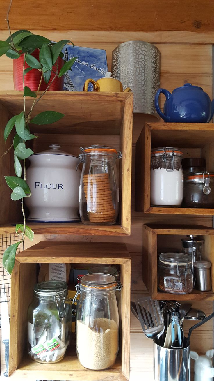 Wall mounted old timber boxes offer flexible kitchen storage