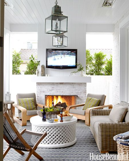 A fireplace and overhead heat lamps make it possible to entertain on this loggia year-round.